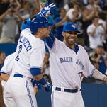 """""""Now, it's up to us,"""" All-Star outfielder Jose Bautista says after a front-office binge netted Troy Tulowitzki, right, and David Price."""