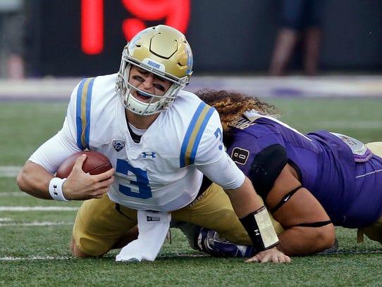 UCLA quarterback Josh Rosen (3) is sacked by Washington's