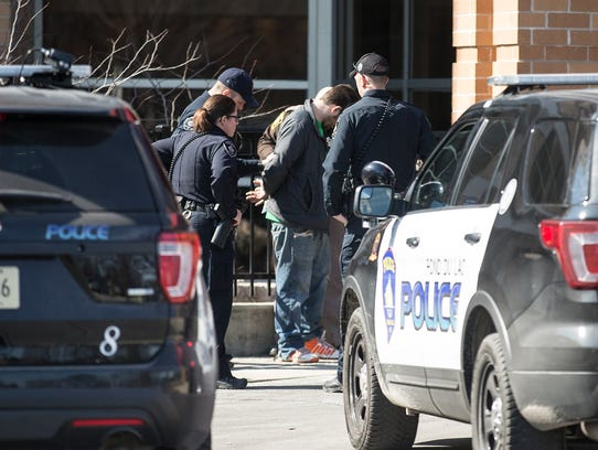 A man is taken into custody Sunday in the St. Agnes