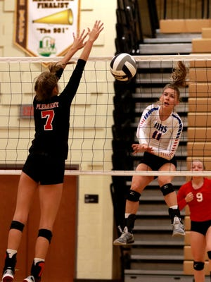 Highland senior All-Ohioan Ashton Terrill hits a kill by Pleasant's Laina Sansotta in a Division III district championship volleyball match Saturday at Buckeye Valley. The Scots are making their third trip to regionals in four years.