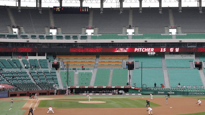 Stadium seats are empty as a part of precaution against the coronavirus during a game Tuesday between Hanwha Eagles and SK Wyverns in Incheon, South Korea.
