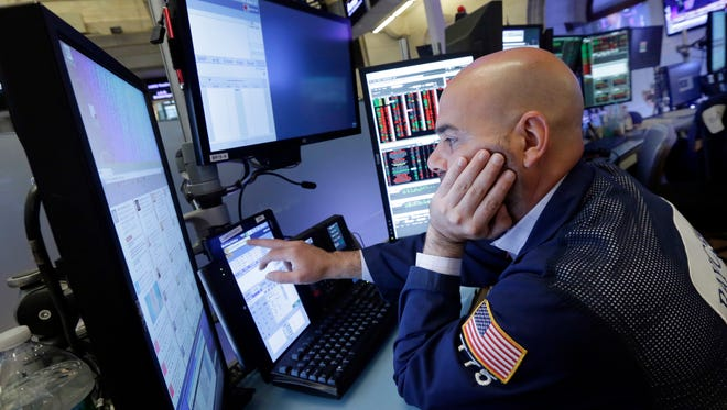 A trader works on the floor of the New York Stock Exchange as U.S. stocks plunge after Britons vote to leave the European Union.