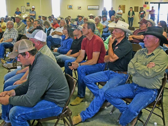 Farmers and ranchers dealing with drought listen during a town hall meeting with Gov. Doug Burgum and Agriculture Commissioner Doug Goehring at the Golden Valley Community Center in Golden Valley, N.D., Wednesday, July 12, 2017. Burgum on Wednesday further relaxed commercial driving restrictions to help drought-stricken North Dakota farmers and ranchers. (Tom Stromme/The Bismarck Tribune via AP)