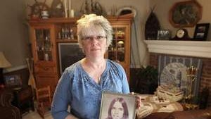 Debbie Melton holds a photo of her brother, Ronnie Roberts, who was abducted from a Yorktown gas station and murdered in 1973. The case was never solved.