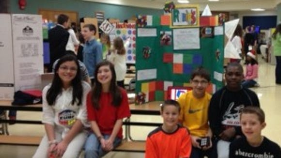 Ana Rivera, Kenna Shanahan, Greg Diakomahalis, Jack Forsythe, Austin Jennings, and Tah-jae Hill made the winning presentation that nominated the Rubik's Cube to the National Toy Hall of Fame.
