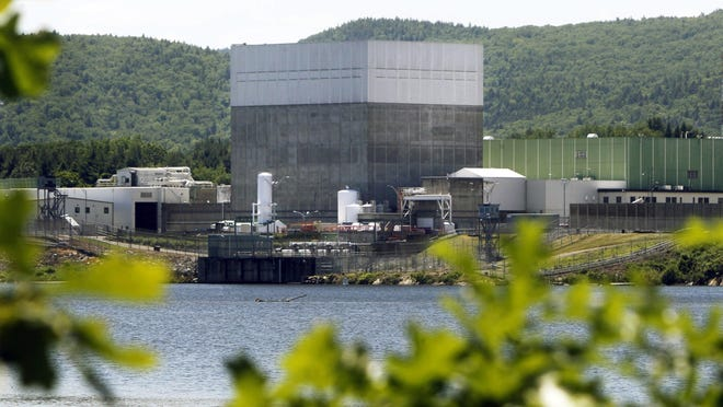 In this June 19, 2013, file photo, the Vermont Yankee Nuclear Power Station sits along the banks of the Connecticut River in Vernon, Vt. The plant was closed at the end of 2014.