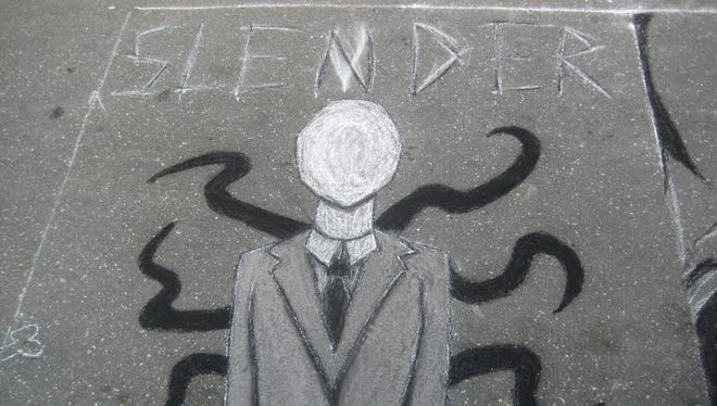 Graffiti of the fictional character Slender Man drawn on a street in Raleigh, N.C.