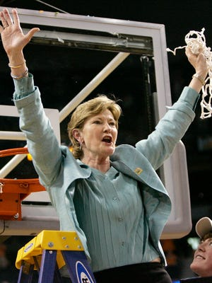 Tennessee coach Pat Summitt holds up the net as her son, Tyler, looks on after Tennessee beat Stanford 64-48 to win its eighth national women's basketball championship at the 2008 Final Four in Tampa, Fla.