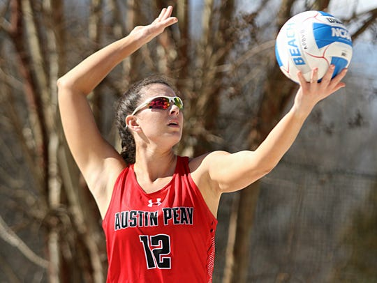 Sophomore Kaylee Taff prepares to serve during Austin