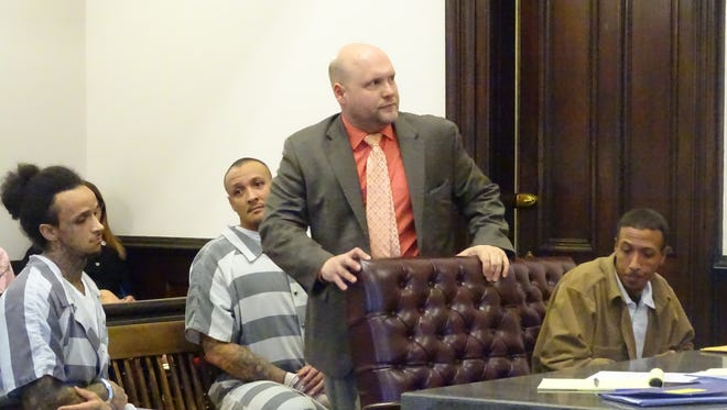 Attorney Dan Guinn, standing, represents, from left, Coshocton County brothers Joshua, Willie and Jason Norfleet during their pretrial hearing Monday on charges of kidnapping, aggravated burglary and other felonies in Coshocton County Common Pleas Court. Judge Robert Batchelor has ordered them to stand trial separately in April.