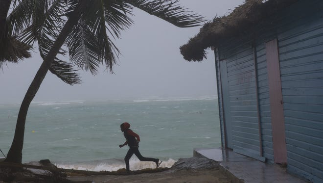 A child plays at El Cortecito beach hours before the arrival of hurricane Maria in Punta Cana, Dominican Republic, Sept. 20, 2017. The speed of Maria's winds reduced after landing in south east Puerto Rico but the danger remains according to the US National Hurricane Center.