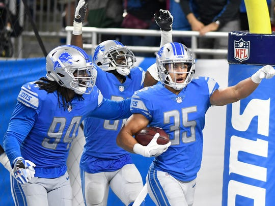 Detroit Lions strong safety Miles Killebrew (35) celebrates his 35-yard interception for a touchdown against the Arizona Cardinals during an NFL football game in Detroit, Sunday, Sept. 10, 2017. Detroit won 35-23. (AP Photo/Jose Juarez)