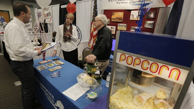 John Kubasta talks with Kristin Ely-Bluemke and Tim Buchen of the Boy Scouts of America Bay Lakes Council, which was one of the nearly 100 exhibitors at the 2016 Oshkosh Chamber Business Expo held at the Oshkosh Convention Center last year.