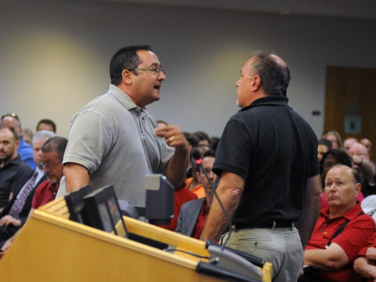 In this file photo, School Board candidate Dean Paterakis is ejected from a board meeting in May 2016 and arrested for disrupting a school function and resisting an officer without violence after he repeatedly refused to leave the speaker's podium. Criminal charges were not filed against Paterakis.
