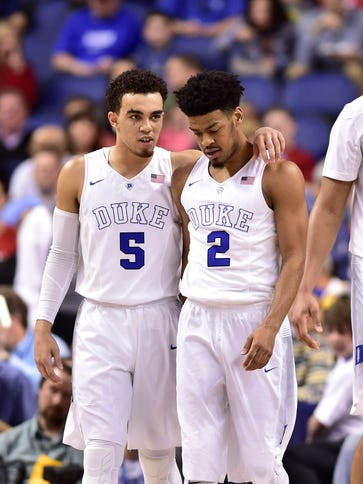 Duke Blue Devils guard Tyus Jones (5) and guard Quinn