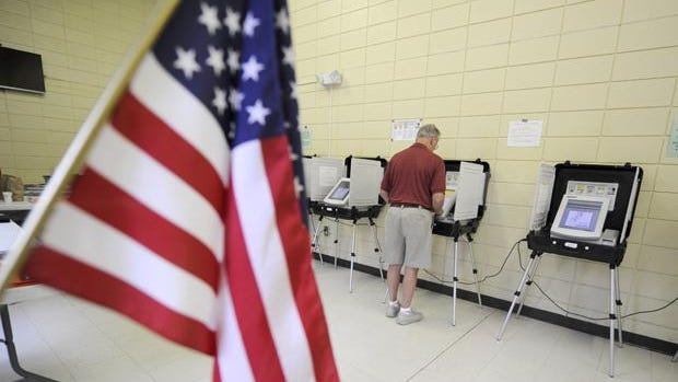 Dale Stencel casts his vote at the Warren Road Community Center in a 2015 runoff election