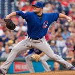 Chicago Cubs starting pitcher Jon Lester (34) pitches