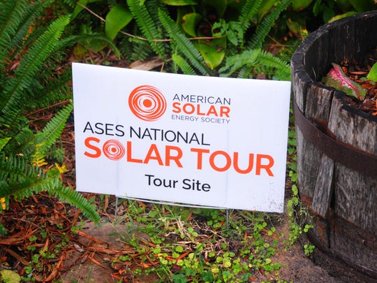 William Young has a sign in front of the house from the solar tour last fall, his home was one of the houses on the tour. William Young, retired research engineer who worked at the Florida Solar Energy Center for 22 years specializing in emergency power, is walking the walk. His Titusville home has numerous solar power systems, on and off the grid, has two hybrid cars that are charged by his solar power system and a VW bus that has solar power for its RV accessories. He is also president of  the Florida chapter of FREA - Florida Renewable energy association.