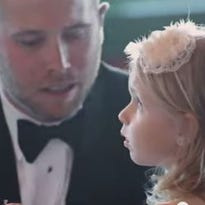 Brian Scott reads vows to his new stepdaughter, Brielle.