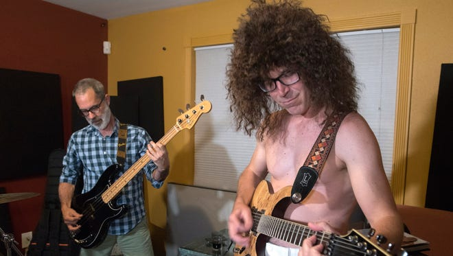 Sean Peterson and Jim Green rehearse cover versions of songs from Van Halen during band practice Wednesday, Sept. 13, 2017.