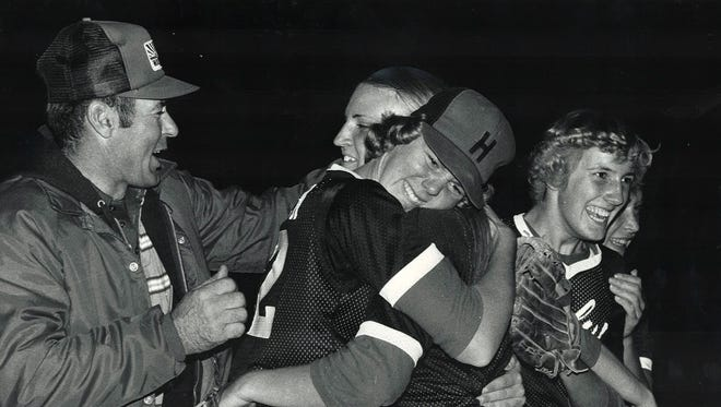 1979: First baseman Tracy Leinen, left, smothers pitcher Marcia Jacobsen with a hug as Diane Kloewer moves in to add congratulations after Harlan beat Ankeny 5-1 in the semifinals of the fall state softball tournament. Harlan went on to lose to Charles City in the fall title game. Jacobsen was named to the all-tournament team. Beginning in 1987, the fall tournament was dropped.