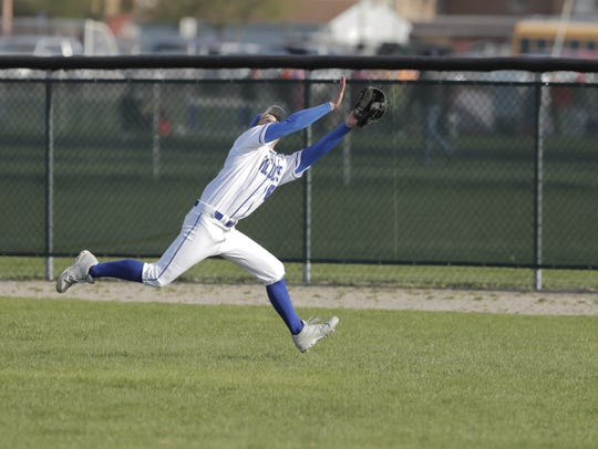 Oshkosh West's Nate Jaeger makes a running catch in