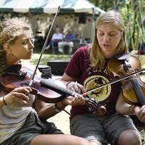 Various instruments are available to try or buy during Saturday's Minnesota Bluegrass & Old-Time Music Festival at El Rancho Manana.