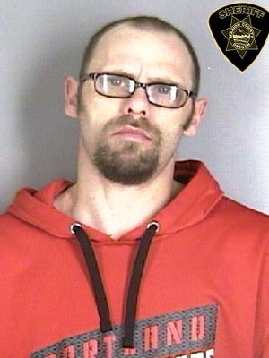 Christopher Robert Smith, 34,  believed to have broken into a number of cars and residences on Martin Court S in Salem on Sunday, Jan. 14, 2018.