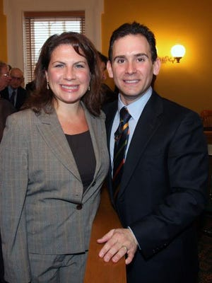 Putnam County Assistant District Attorney Chana Krauss and District Attorney Adam Levy pose for a photo after he was sworn in during a ceremony at the Putnam County Courthouse in Carmel on Jan. 1, 2008.
