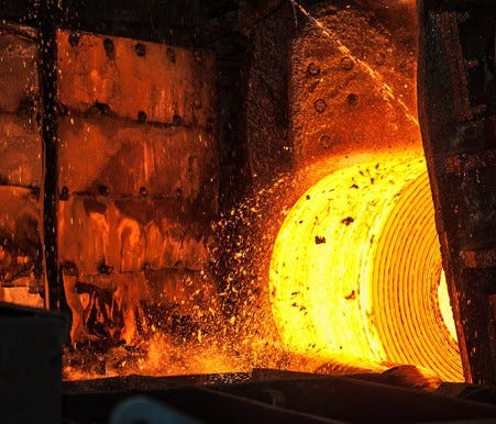 A hot roll of steel in a steel mill.