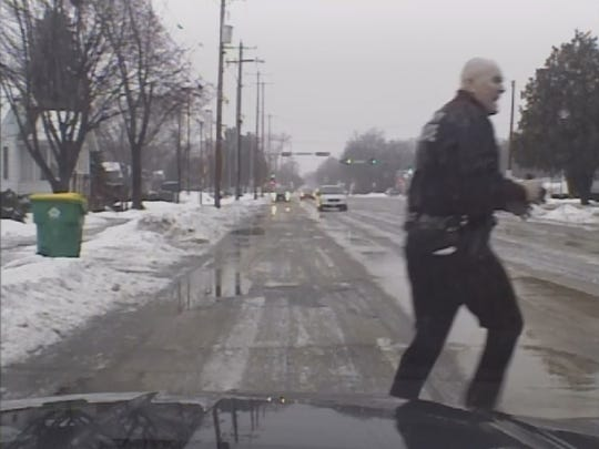 Green Bay police officer Mike Francois chases a man suspected of robbery the Walgreen's store on East Mason Street at gunpoint in this image captured by his squad cars dash camera.