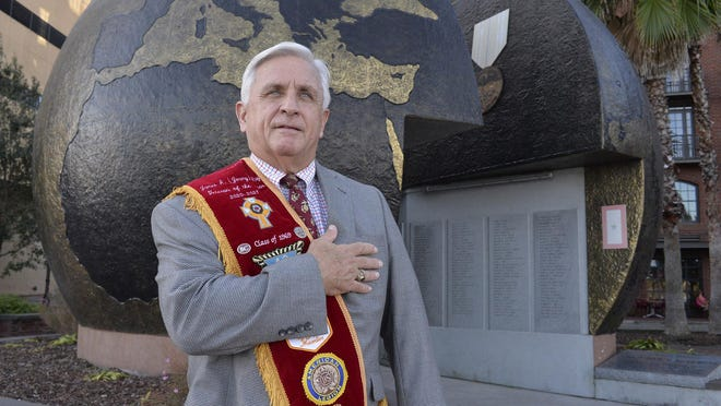 Jimmy Ray, Veteran of the Year, stands in front of the sphere of the World War II Monument on River Street. Ray was on the committee to build the monument.