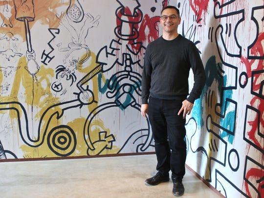 Cranbrook Art Museum director Andrew Blauvelt in the Keith Haring mural corridor.