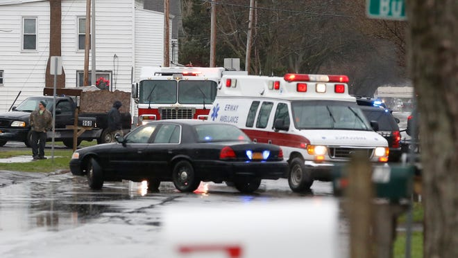 An Erway Ambulance rushes off following a motor vehicle crash on Sullivan Street in Elmira Thursday afternoon.