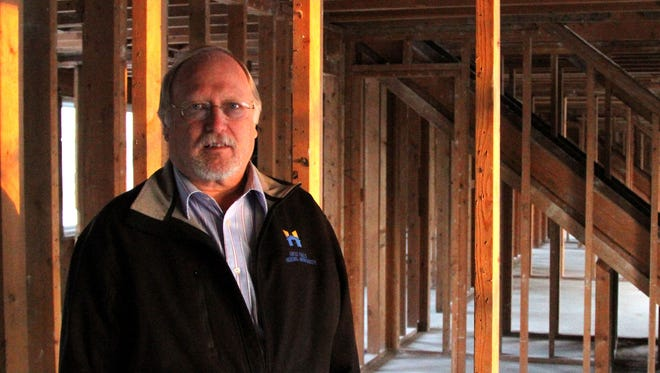 Kevin Hager stands inside a stripped down 10-plex apartment building during a 2012 renovation of the Parkdale Public Housing Complex in Great Falls.