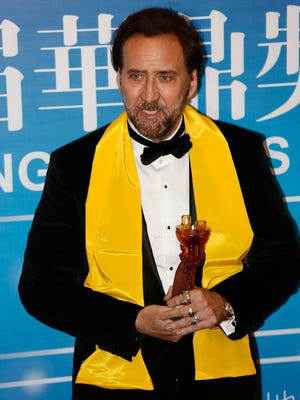 Actor Nicholas Cage poses with his award after he won the Best Global Actor in Motion Pictures award at the 10th Huading Awards ceremony in Macau.