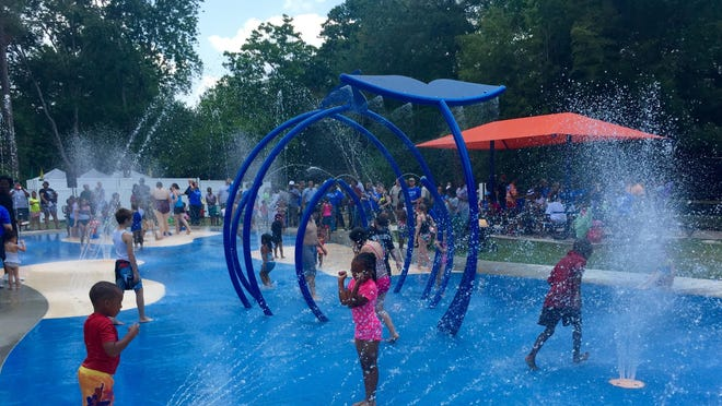 Children enjoy the new Splash Pad at the Louisiana Purchase Gardens and Zoo.