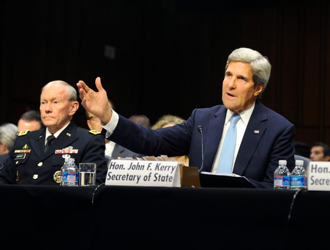 Gen. Martin Dempsey, chairman of the Joint Chiefs of Staff, left, Secretary of State John Kerry and Secretary of Defense Chuck Hagel,  testify before the U.S. Senate Committee on Foreign Relations about the authorization of use of force in Syria.