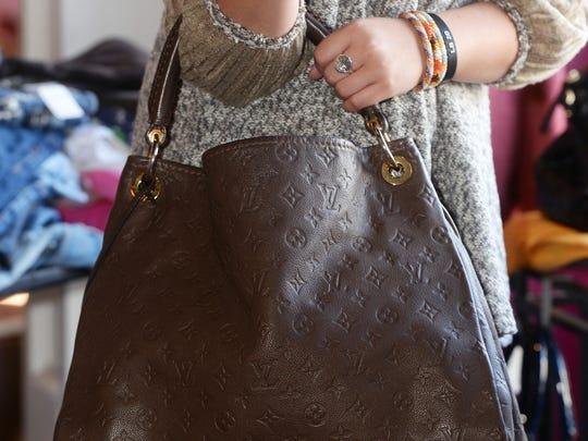 This Louis Vuitton Artsy Empreinte handbag sells for