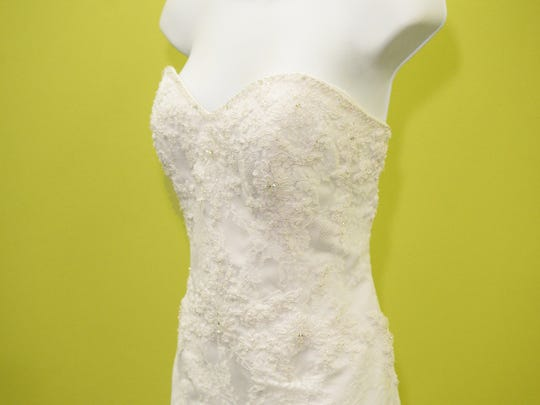 "An Alfred Angelo ""Saphire"" gown for $499.00 found at New To You consignment."