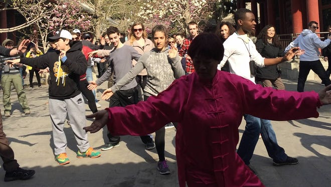 Students practice Tai Chi inside the Forbidden City/Imperial Palace in Beijing.
