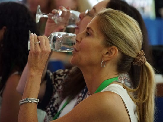 Bottoms up: participants at the 2017 Food & Wine Classic in Aspen, Colo., taste wine during a seminar.