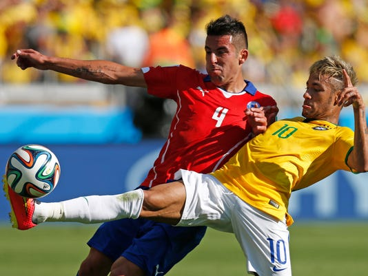 APTOPIX Brazil Soccer_Muno.jpg