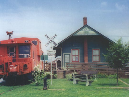 The Enosburgh Historical Society Museum was the former freight depot. They bought 300 feet of the freight tracks when they removed the tracks to make way for the rail trail. They bought a caboose and transported it from Swanton to place on the tracks. The caboose houses railroad memorabilia.