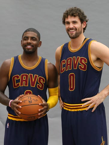 Cleveland Cavaliers' Kyrie Irving, left, and Kevin