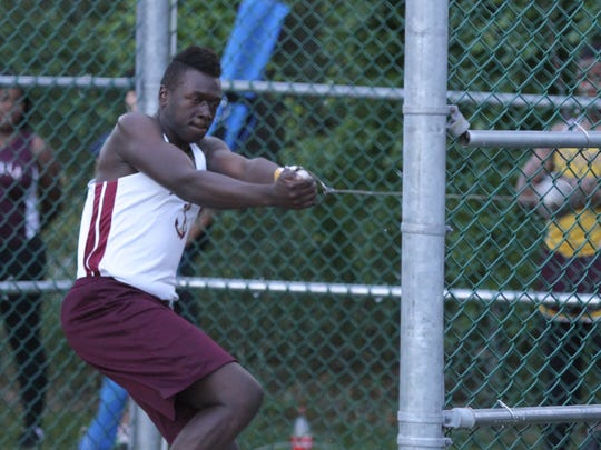 Arlington's Tim Criss wins the hammer throw in the