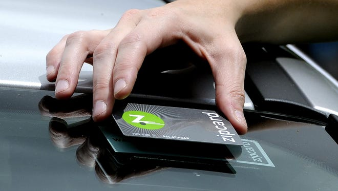 In this Aug. 21, 2013, file photo a woman tries out a Zipcard in Conway, S.C.