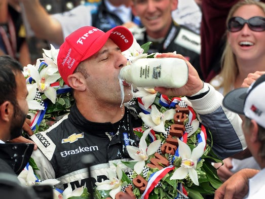 Driver Tony Kanaan chugs the milk in Victory Circle after winning his first Indianapolis 500 race at the Indianapolis Motor Speedway Sunday, May 26 2013. (Matt Detrich / The Star)