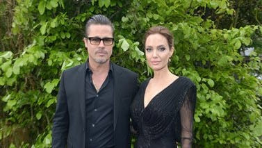 Actors Brad Pitt and Angelina Jolie arrive at the Maleficent exhibit in Kensington Gardens, London, Thursday, May 8, 2014. The exhibit showcases some of the costumes and props from the film Maleficent, before they go on display to the public at the O2 in London.