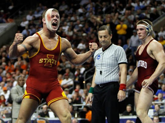 Jon Reader celebrates a victory while a college wrestler at Iowa State.